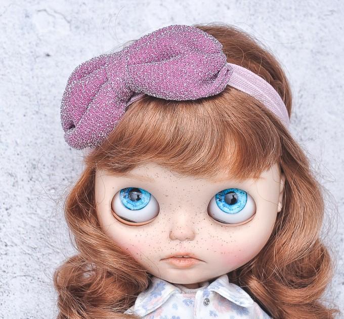 Blythe pink elasticized headband  with decorative bow