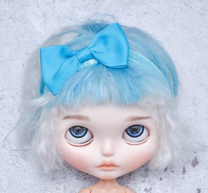 Blythe blue elasticized headband  with decorative bow